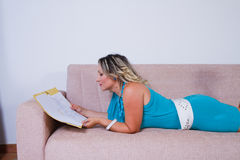 Woman reading reports Stock Photography