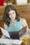 Woman reading restaurant card Stock Photo