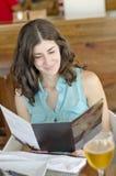 Woman reading restaurant card Stock Photo