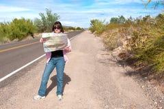 Woman reading roadmap Stock Image