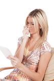 Woman reading sad Royalty Free Stock Photography