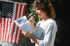 Woman reading sample voting ballot Royalty Free Stock Photos