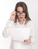Woman reading shocking document Royalty Free Stock Photo