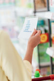 Woman reading a shopping list Stock Images