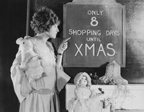 Woman reading sign with number of shopping days until Christmas Royalty Free Stock Image