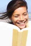 Woman reading smiling Royalty Free Stock Photo