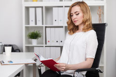 Woman reading specialized literature Royalty Free Stock Photo