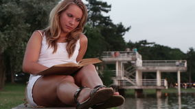 Woman reading at sunset stock video footage