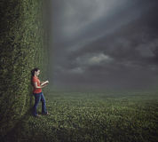 Woman reading on surreal landscape. Stock Images