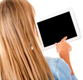 Woman reading on a tablet computer Stock Photo