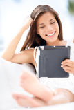 Woman reading on tablet computer - smiling, relax Stock Photos
