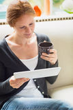 Woman Reading from a Tablet Stock Photos
