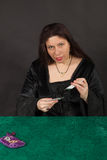 A woman is reading tarot cards Royalty Free Stock Image