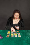 A woman is reading tarot cards Stock Image