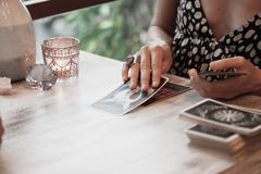 Woman is reading Tarot cards royalty free stock photography
