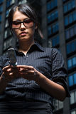 Woman reading a text message Stock Photography