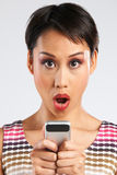 Woman Reading Text Message With Shocked Expression Stock Photography
