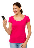 Woman Reading Text Message On Smart Phone Royalty Free Stock Image