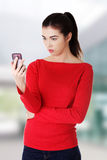 Woman reading text message Royalty Free Stock Photo