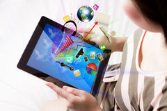 Woman reading the touch screen device. Royalty Free Stock Photo