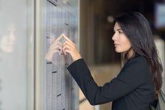 Woman reading train timetable Stock Photos