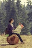 Woman reading travel map Stock Photography