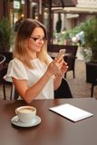 Woman reading or typing on mobile phone. stock photo