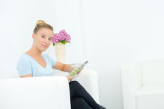 Woman reading in waiting room Stock Photos