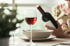 Woman reading a wine label Stock Photo