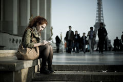 Woman readng at trocadero place near Eiffel tower Stock Photography