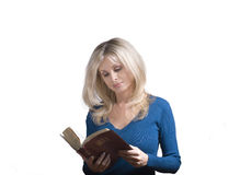 Woman reads a Bible Stock Photo
