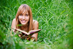 Woman reads book Royalty Free Stock Images