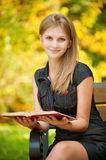 Woman reads book Royalty Free Stock Image