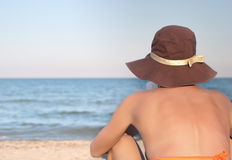 Woman reads book on the beach Royalty Free Stock Photography