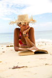 Woman reads a book on beach Royalty Free Stock Images