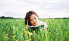 Woman reads a book Stock Photos