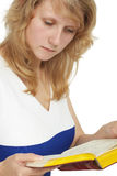 A woman reads a book close-up on white Royalty Free Stock Photography
