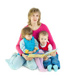 The woman reads the book to children Stock Image