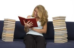 A woman reads books. A woman must have read many books Royalty Free Stock Photos