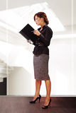 Woman reads documents royalty free stock image