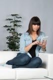 Woman reads an ebook Stock Photos
