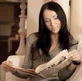 Woman reads a magazine Stock Photos
