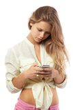 Woman reads  from a mobile phone Royalty Free Stock Image
