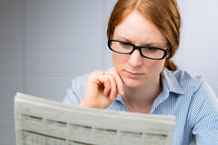 Woman Reads the Daily News Stock Photo