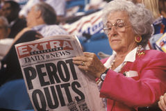 Woman reads Perot Quits Stock Image