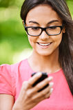 Woman reads text message on Stock Image