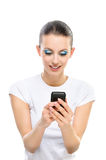 Woman reads text message on mobile. Portrait young beautiful serious dark-haired woman in white T-shirt which reads text message on mobile phone, isolated on Royalty Free Stock Image