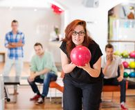 Woman Ready With Bowling Ball in Club Royalty Free Stock Image