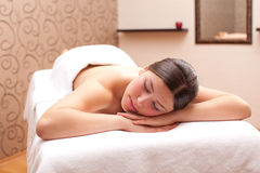 Woman ready for massage in a spa setting Royalty Free Stock Photos