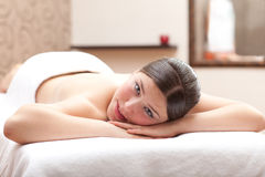 Woman ready for massage in a spa setting Stock Image